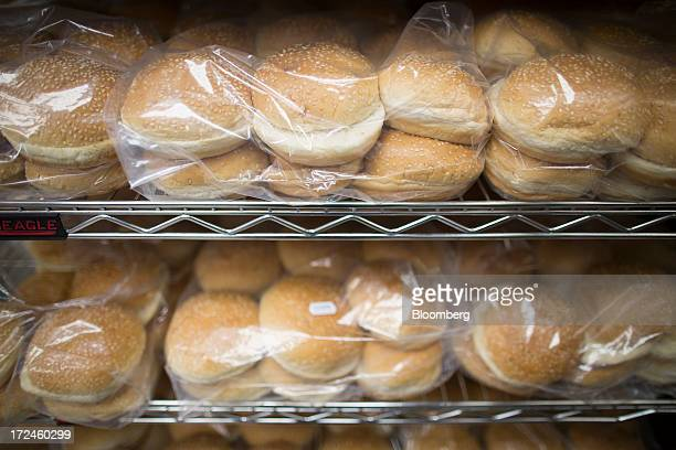 Hamburger bread rolls sit in packaging on shelves ahead of use in the kitchen at the first UK outlet of US burger restaurant chain Five Guys in...