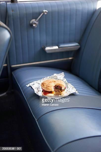 Hamburger on back seat of vintage car