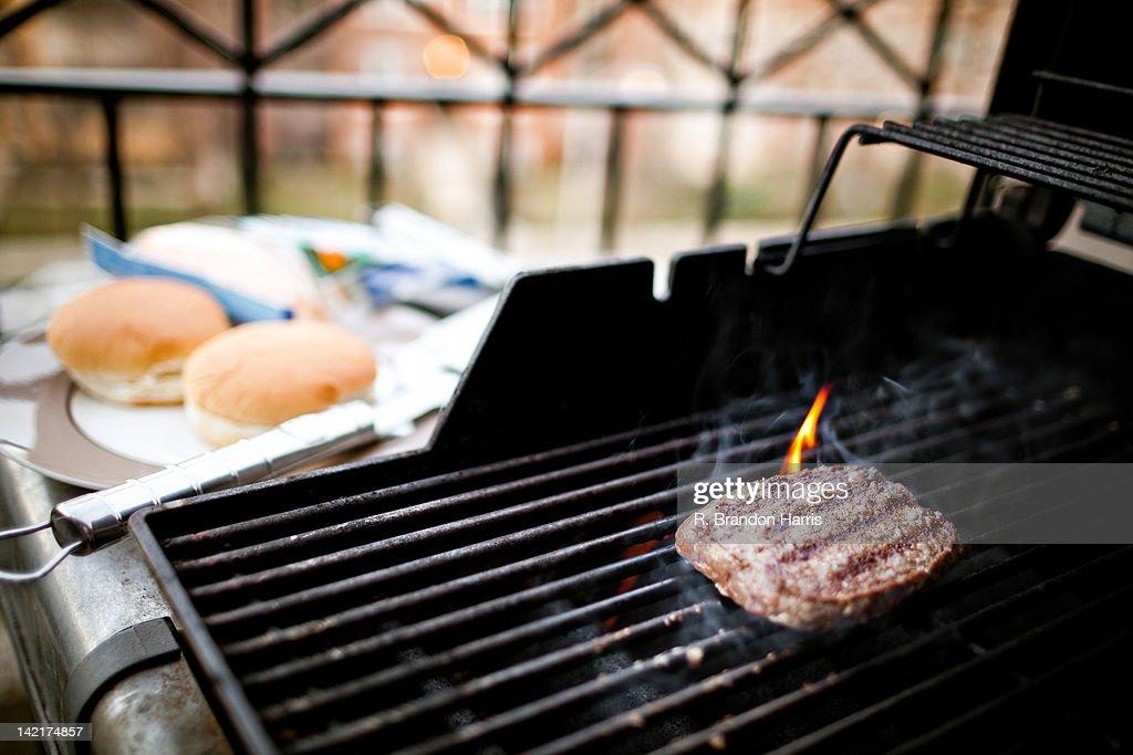 Hamburger on grill : Stock Photo