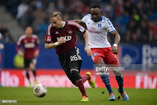 FUSSBALL 1 BUNDESLIGA SAISON Hamburger SV 1 FC Nuernberg Javier Pinola gegen Jacques Zoua