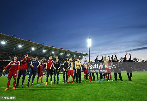 Hamburger SV players and staff celebrate victory after the Bundesliga playoff second leg match between Karlsruher SC and Hamburger SV on June 1 2015...