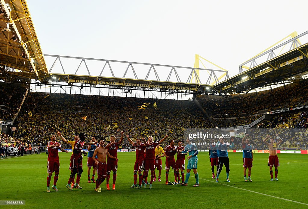 Hamburger SV players celebrate victory after the Bundesliga match between Borussia Dortmund and Hamburger SV at Signal Iduna Park on October 4, 2014 in Dortmund, Germany.