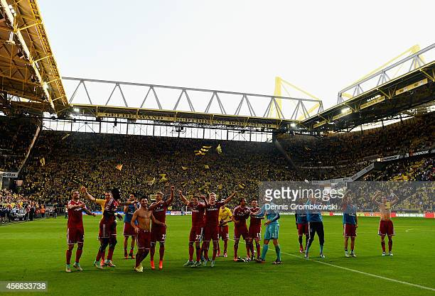 Hamburger SV players celebrate victory after the Bundesliga match between Borussia Dortmund and Hamburger SV at Signal Iduna Park on October 4 2014...