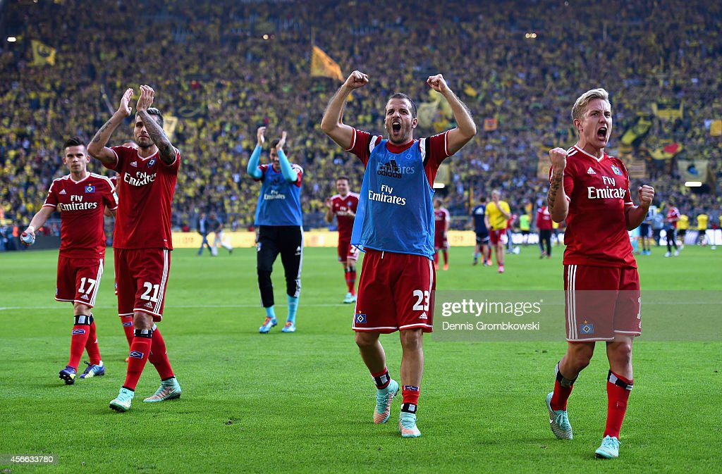 Hamburger SV players Lewis Holtby and Rafael van der Vaart celebrate victory after the Bundesliga match between Borussia Dortmund and Hamburger SV at Signal Iduna Park on October 4, 2014 in Dortmund, Germany.
