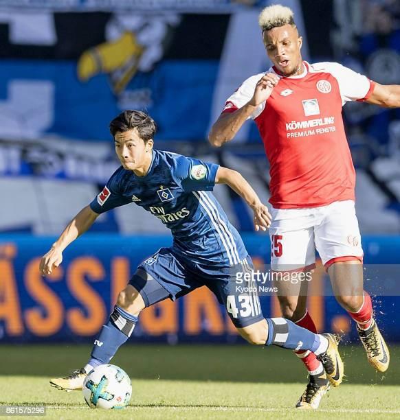 Hamburger SV striker Tatsuya Ito escapes the attentions of FSV Mainz 05 midfielder JeanPhilippe Gbamin during a German Bundesliga match at Opel Arena...