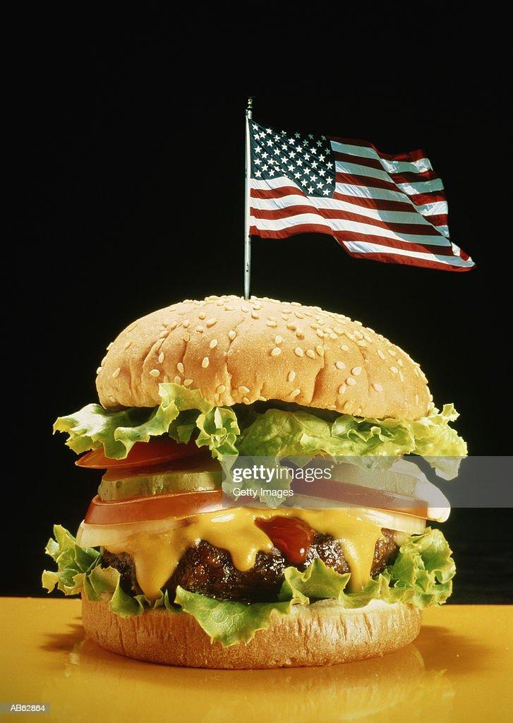 Hamburger with American flag waving in top of bun : Stock Photo