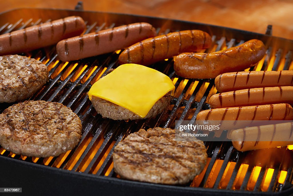 hamburgers and hot dogs on grill stock photo getty images. Black Bedroom Furniture Sets. Home Design Ideas