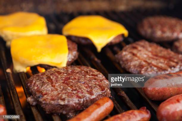 Hamburgers cheeseburgers and hot dogs on grill