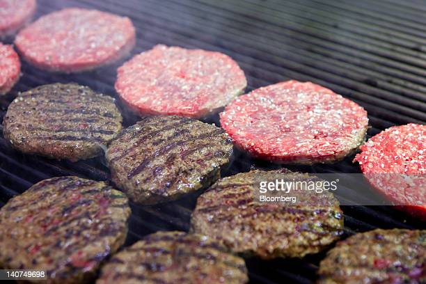 Hamburgers cook on a grill in the kitchen of an h3 Hamburger Co restaurant in Lisbon Portugal on Saturday March 3 2012 Portugal in April became the...