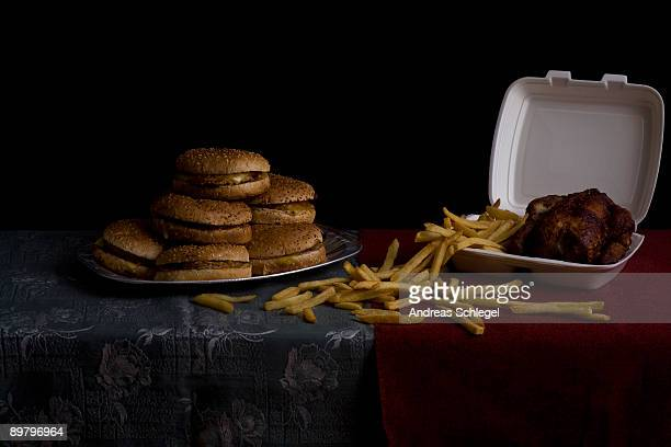 Hamburgers, French fries and roasted chicken, still life