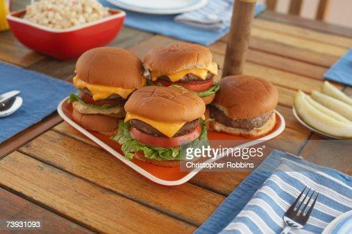 Hamburgers on a laid picnic table : Stock Photo
