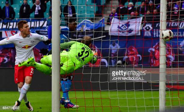 Hamburg's Brazilian defender Walace Souza Silva scores during the Bundesliga match RB Leipzig vs Hamburger SV in Leipzig on February 11 2017 / AFP /...