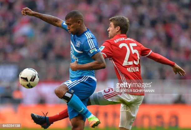 Hamburg's Brazilian midfielder Walace and Bayern Munich's German striker Thomas Mueller vie for the ball during the German first division Bundesliga...