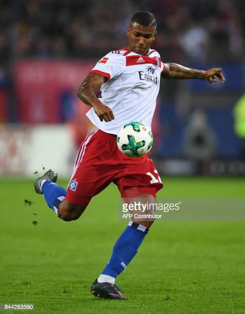 Hamburg's Brazilian midfielder Walace kicks the ball during German first division Bundesliga football match between Hamburger SV and RB Leipzig in...