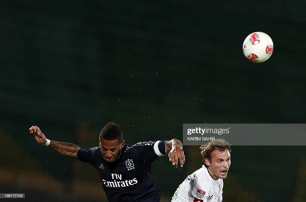 Hamburg's defender Dennis Aogo (L) and Borussia Monchengladbach's midfielder Tony Jantschke jump to head the ball during their friendly football match in the Gulf emirate of Dubai on January 9, 2013.
