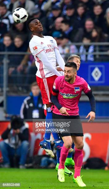 Hamburg's defender Gideon Jung vies with Berlin's Bosnian forward Vedad Ibisevic during the German First division Bundesliga football match between...