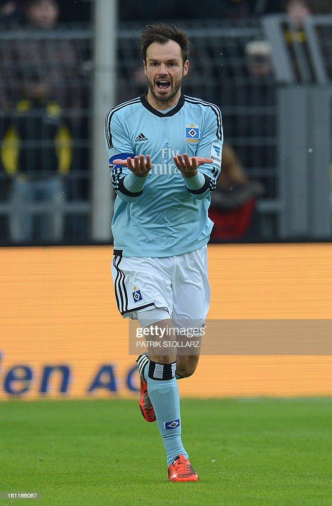Hamburg's defender Heiko Westermann reacts during the German first division Bundesliga football match Borussia Dortmund vs Hamburger SV in Dortmund, western Germany, on February 9, 2013. Hamburg won 1-4.