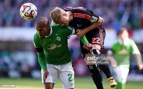 Hamburg's defender Matthias Ostrzolek and Bremen's Czech defender Theodor Gebre Selassie vie for the ball during the German first division Bundesliga...