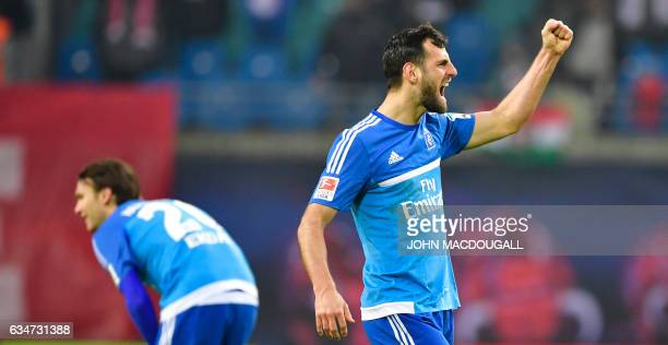 Hamburg's defender Mergim Mavraj celebrates after their third goal during the Bundesliga match RB Leipzig vs Hamburger SV in Leipzig on February 11...