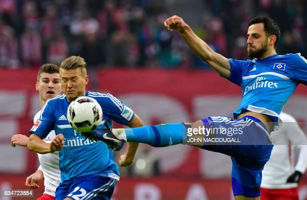 Hamburg's defender Mergim Mavraj kicks the ball during the Bundesliga match RB Leipzig vs Hamburger SV in Leipzig on February 11 2017 / AFP / John...