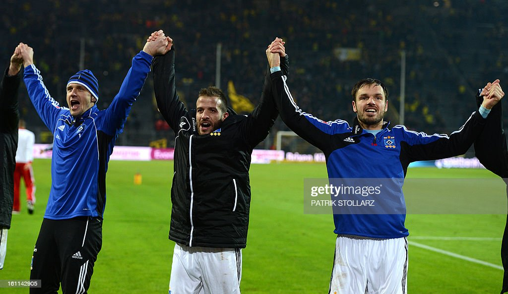 Hamburg's Dutch midfielder Rafael van der Vaart celebrates with teammates at the end of the German first division Bundesliga football match Borussia Dortmund vs Hamburger SV in the German city of Dortmund on February 9, 2013. Hamburg won 1-4. DFL rules to limit the Onlines usage during matchtime to 15 pictures per match. Image sequences to simulate video is not allowed at any time. For further queries please contact DFL directly at + 49 69 650050.