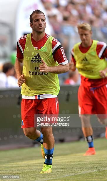 Hamburg's Dutch midfielder Rafael van der Vaart warms up during the Telekom Cup semifinal football match Hamburg SV vs VfL Wolfsburg in the norhtern...