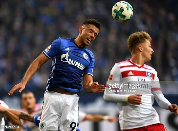 Hamburg's German forward JannFiete Arp and Schalke's Argentinian forward Franco di Santo vie for the ball during the German First division Bundesliga...