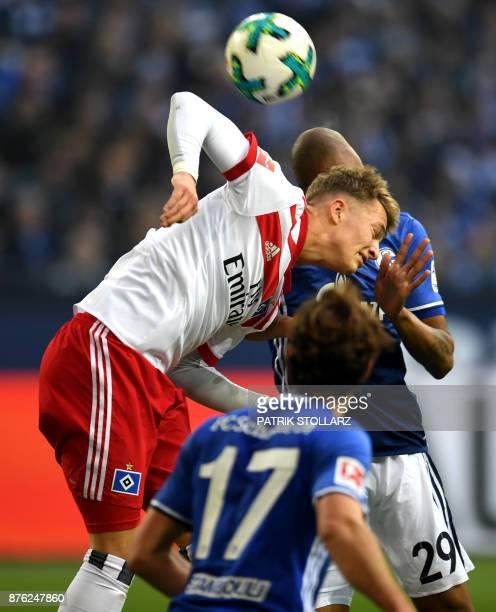 Hamburg's German forward JannFiete Arp and Schalke's Brazilian defender Naldo vie for the ball during the German First division Bundesliga football...