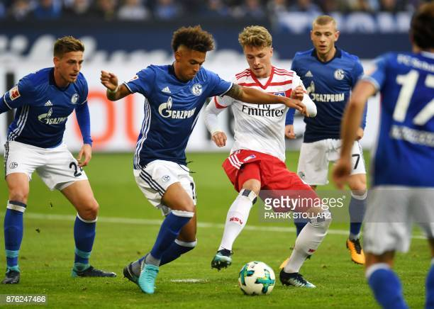 Hamburg's German forward JannFiete Arp and Schalke's German defender Thilo Kehrer vie for the ball during the German First division Bundesliga...