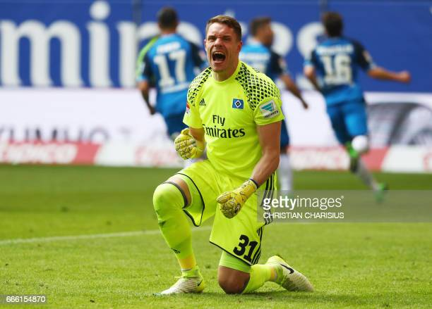 Hamburg's goalkeeper Christian Mathenia reacts after failling to save Hoffenheim's Croatian forward Andrej Kramaric's penalty during the German first...