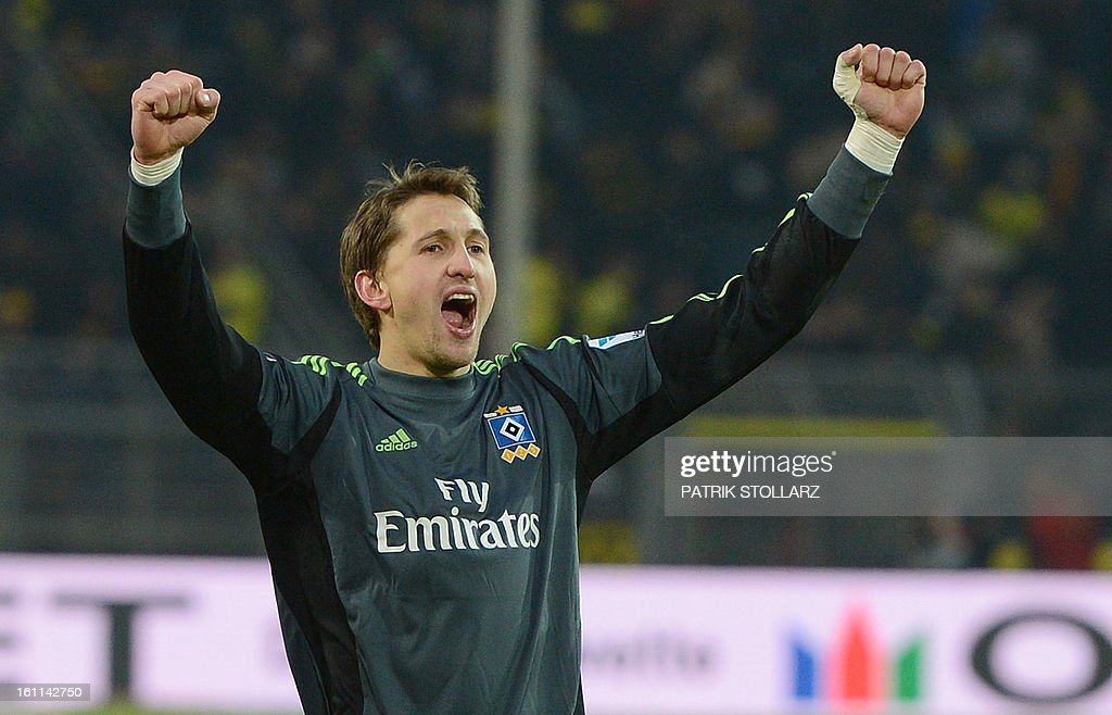 Hamburg's goalkeeper Rene Adler celebrates at the end of the German first division Bundesliga football match Borussia Dortmund vs Hamburger SV in the German city of Dortmund on February 9, 2013. Hamburg won 1-4. AFP PHOTO / PATRIK STOLLARZ DFL rules to limit the Onlines usage during matchtime to 15 pictures per match. Image sequences to simulate video is not allowed at any time. For further queries please contact DFL directly at + 49 69 650050.