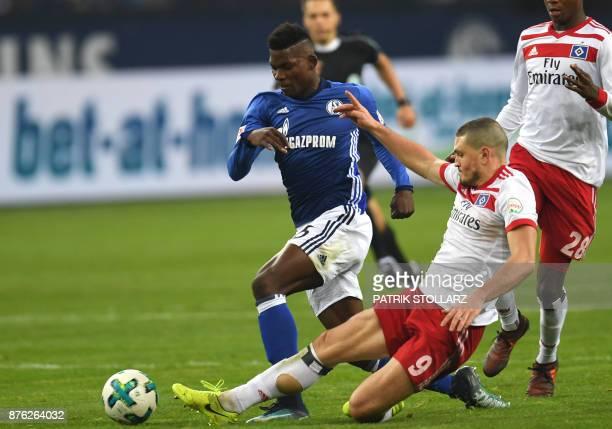 Hamburg's Greek defender Kiriakos Papadopoulos and Schalke's Swiss midfielder Breel Embolo vie for the ball during the German First division...