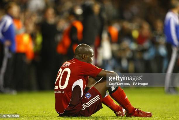 Hamburg's Guy Demel sits dejected after the final whistle