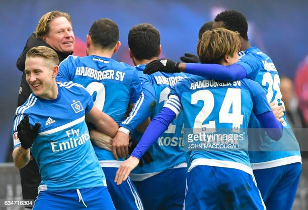 Hamburg's head coach Markus Gisdol celebrates with players after Hamburg's Brazilian defender Walace Souza Silva scored a second goal during the...