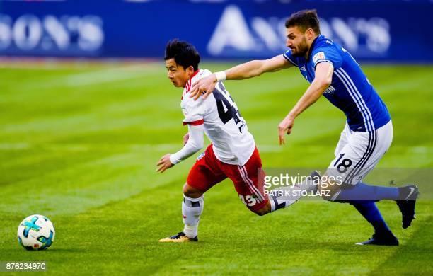 Hamburg's Japanese midfielder Tatsuya Ito and Schalke's midfielder Daniel Caligiuri vie for the ball during the German First division Bundesliga...