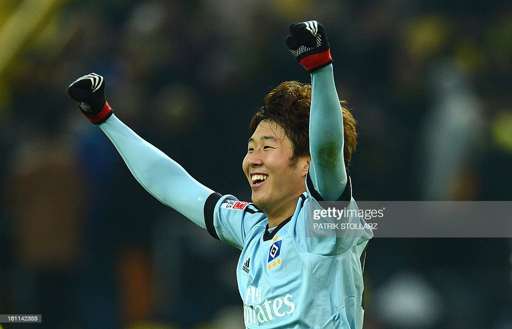 Hamburg's Korean striker Heung Min Son celebrates at the end of the German first division Bundesliga football match Borussia Dortmund vs Hamburger SV in the German city of Dortmund on February 9, 2013. Hamburg won 1-4. DFL rules to limit the Onlines usage during matchtime to 15 pictures per match. Image sequences to simulate video is not allowed at any time. For further queries please contact DFL directly at + 49 69 650050.