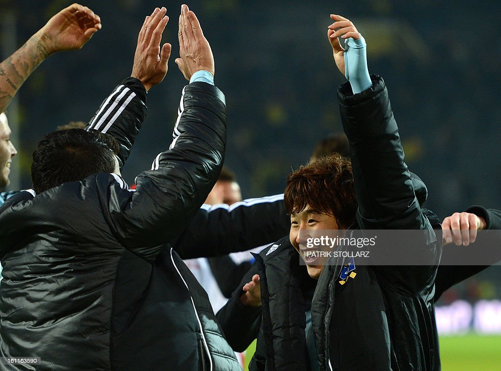 Hamburg's Korean striker Heung Min Son celebrates with teammates at the end of the German first division Bundesliga football match Borussia Dortmund vs Hamburger SV in the German city of Dortmund on February 9, 2013. Hamburg won 1-4. DFL rules to limit the Onlines usage during matchtime to 15 pictures per match. Image sequences to simulate video is not allowed at any time. For further queries please contact DFL directly at + 49 69 650050.