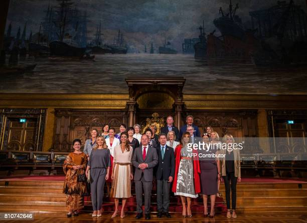 Hamburg's mayor Olaf Scholz poses with partners of the G20 summit participants at the city hall in Hamburg northern Germany on July 8 2017 Leaders of...