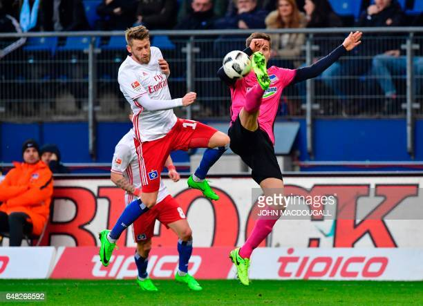 Hamburg's midfielder Aaron Hunt vies with Berlin's defender Niklas Stark during the German First division Bundesliga football match between Hamburg...