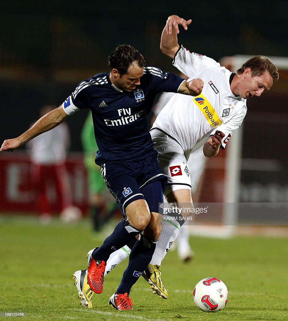 Hamburg's midfielder Heiko Westermann (L) challenges Borussia Monchengladbach's forward Luuk De Jong during their friendly football match in the Gulf emirate of Dubai on January 9, 2013.