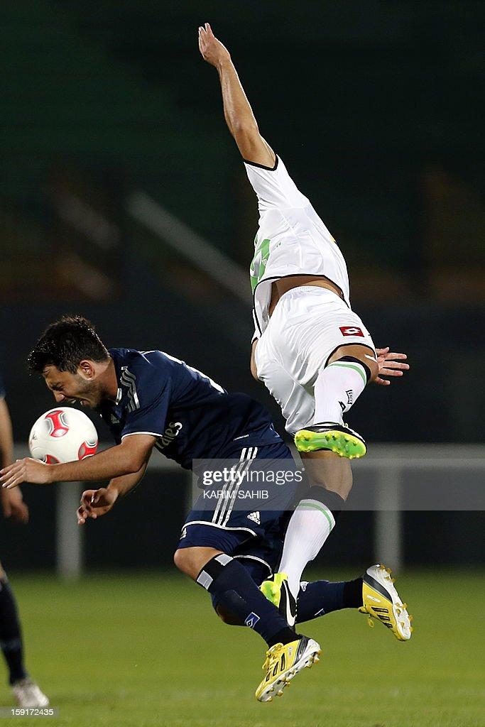Hamburg's midfielder Tolgay Arslan (L) is challenged by Borussia Monchengladbach's midfielder Juan Arango during their friendly football match in the Gulf emirate of Dubai on January 9, 2013.