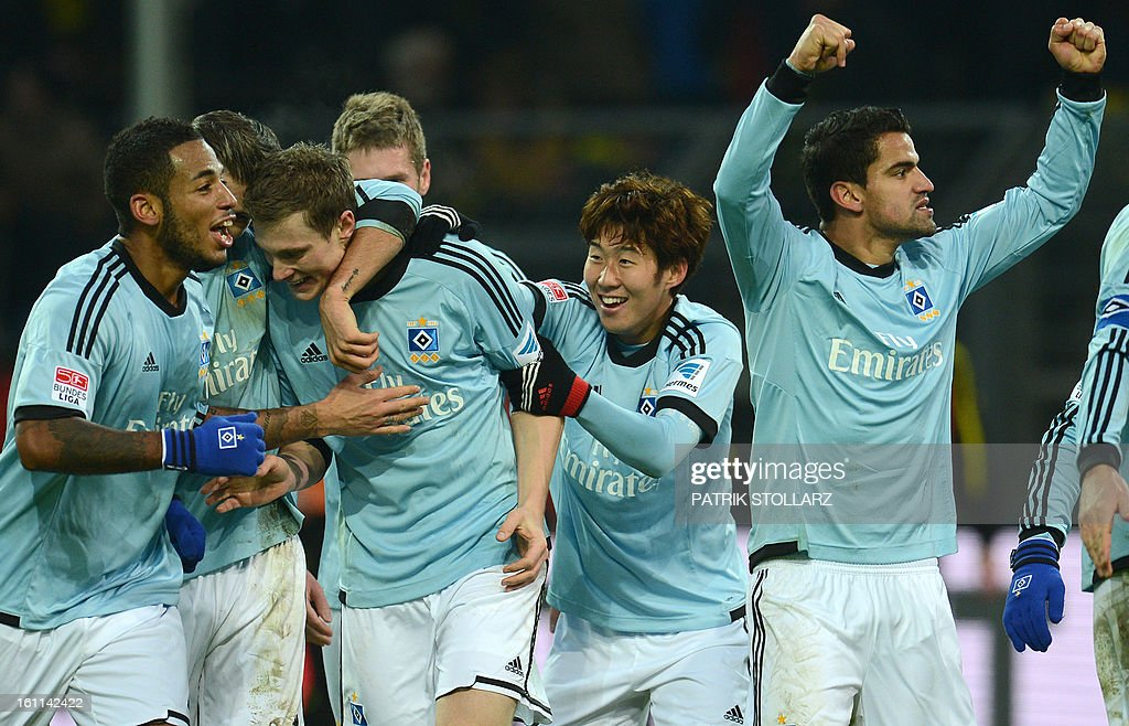 Hamburg's players celebrate during the German first division Bundesliga football match Borussia Dortmund vs Hamburger SV in the German city of Dortmund on February 9, 2013. Hamburg won 1-4. AFP PHOTO / PATRIK STOLLARZ DFL rules to limit the Onlines usage during matchtime to 15 pictures per match. Image sequences to simulate video is not allowed at any time. For further queries please contact DFL directly at + 49 69 650050.