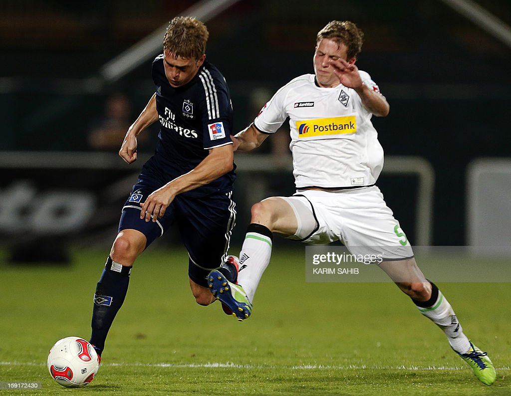Hamburg's striker Artjoms Rudnevs (L) challenges Borussia Monchengladbach's midfielder Alexander Ring during their friendly football match in the Gulf emirate of Dubai on January 9, 2013.