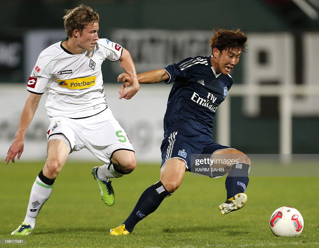 Hamburg's striker Son Heung-Min (R) challenges Borussia Monchengladbach's midfielder Alexander Ring during their friendly football match in the Gulf emirate of Dubai on January 9, 2013.