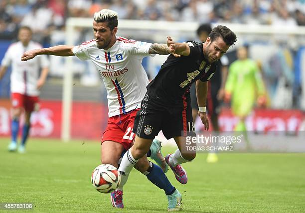 Hamburg's Swiss midfielder Valon Behrami and Bayern Munich's Spanish defender Juan Bernat vie for the ball during the German first division...