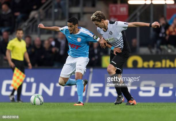 Hamdi Dahmani of Koeln is challenged by Daniel Stanese of Aalen during the third league match between VfR Aalen and Fortuna Koeln on April 4 2017 in...