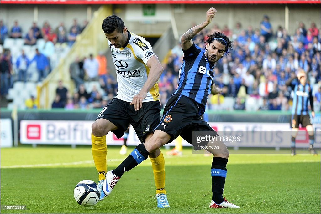 Hamdi Harbaoui of Sporting Lokeren OVL (L) battles for the ball with Lior Refaelov of Club Brugge KV during the Jupiler Pro League play-off 1 match between Club Brugge and Sporting Lokeren on May 5, 2013 in Brugge, Belgium.