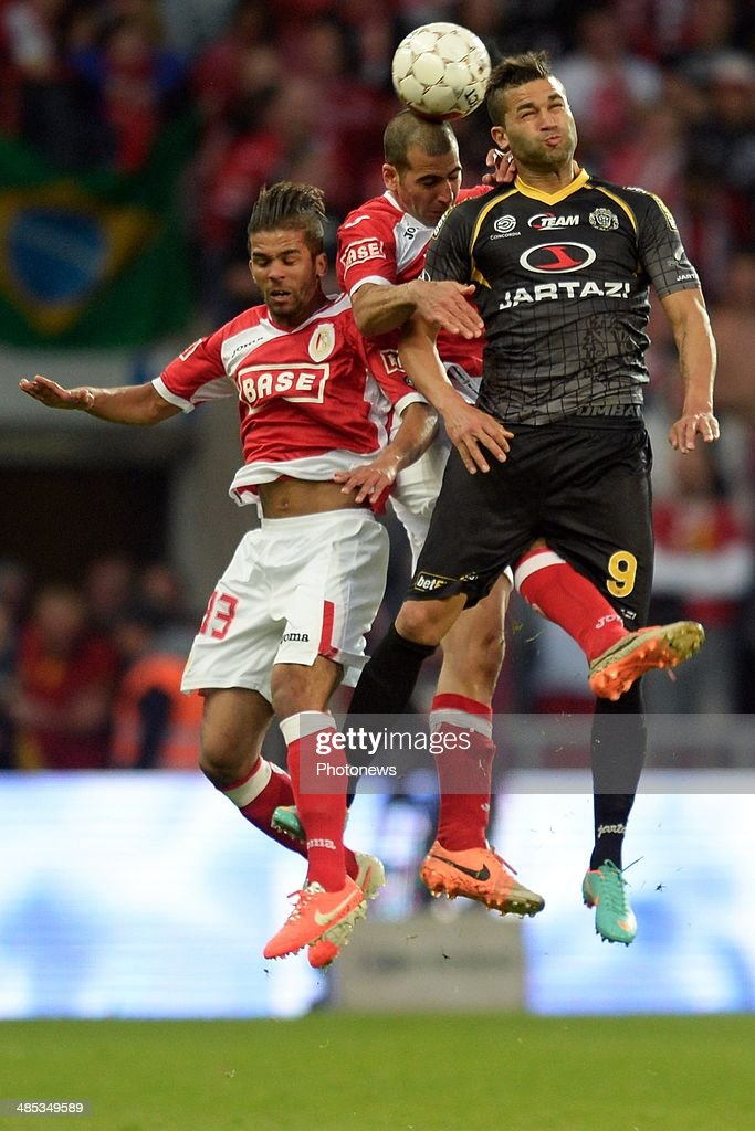 <a gi-track='captionPersonalityLinkClicked' href=/galleries/search?phrase=Hamdi+Harbaoui&family=editorial&specificpeople=3054799 ng-click='$event.stopPropagation()'>Hamdi Harbaoui</a> of Sporting Lokeren OVL battles for the ball with <a gi-track='captionPersonalityLinkClicked' href=/galleries/search?phrase=Mehdi+Carcela-Gonzalez&family=editorial&specificpeople=6539324 ng-click='$event.stopPropagation()'>Mehdi Carcela-Gonzalez</a> of Standard and Tal <a gi-track='captionPersonalityLinkClicked' href=/galleries/search?phrase=Ben+Haim&family=editorial&specificpeople=2626543 ng-click='$event.stopPropagation()'>Ben Haim</a> of Standard during the Jupiler Pro league Play Off 1 match between Standard de Liege and Sporting Lokeren at the Sclessin Stadium on April 17, 2014 in Liege, Belgium.