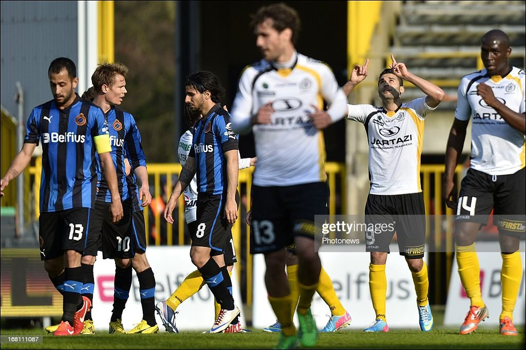 Hamdi Harbaoui of Sporting Lokeren OVL (2nd R) celebrates scoring a goal during the Jupiler Pro League play-off 1 match between Club Brugge and Sporting Lokeren on May 5, 2013 in Brugge, Belgium.