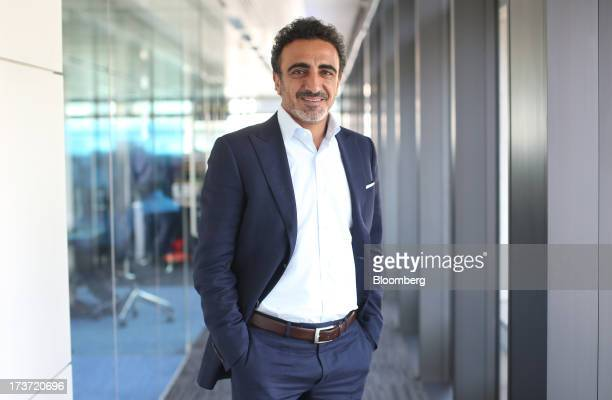 Hamdi Ulukaya a billionaire and founder president and chief executive officer of Chobani Inc poses for a photograph in London UK on Wednesday July 17...